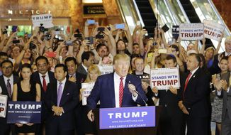 FILE - In this Sept. 3, 2015 file photo, Republican presidential candidate Donald Trump holds a news conference in the lobby of Trump Tower in New York. (AP Photo/Mark Lennihan, File)
