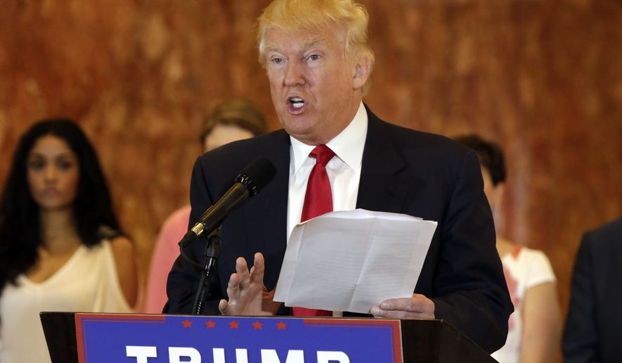 Republican presidential candidate Donald Trump reads from a list of donations to veteran's groups, during a news conference in New York, Tuesday, May 31, 2016. (AP Photo/Richard Drew)