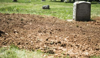 The site where the remains of a Jane Doe were buried is shown after investigators exhumed the body, at Mt. Lebanon Cemetery, Tuesday, May 31, 2016, in Lebanon, Pa. Investigators are hoping to identify a woman who was found dead in the woods along Moonshine Road in Union Township on Oct. 10, 1973 and was buried in the Lebanon cemetery. (Jeremy Long/Lebanon Daily News via AP) THE PATRIOT-NEWS OUT; MANDATORY CREDIT
