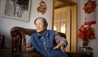 In this Tuesday, May 17, 2016, file photo, Cheng Bi, a 93-year-old retired Beijing school administrator, pauses during an interview at her home in Beijing. Cheng was abused by many students but believes two students — whose names she still remembers — should have apologized for their particularly brutal acts against her during the Cultural Revolution. (AP Photo/Mark Schiefelbein)