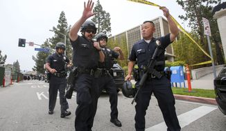 Police officers work at the scene of a fatal shooting at the University of California, Los Angeles, Wednesday, June 1, 2016, in Los Angeles. (AP Photo/Ringo H.W. Chiu)