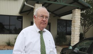 In this May, 25, 2016, file photo, Baylor University President Ken Starr leaves a terminal at the airport in Waco, Texas. Starr resigned as Baylor's chancellor Wednesday, June 1, 2016, a week after he was removed as president of the Texas school amid a scandal over its treatment of sexual assault cases involving football players. (Rod Aydelotte/Waco Tribune Herald, via AP, File)