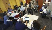 In this Feb. 12, 2015, file photo, Affordable Care Act navigators hold an enrollment event at the Fort Worth Public Library in Fort Worth, Texas. (AP Photo/LM Otero, File)
