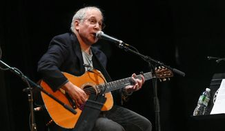 "In this Oct. 6, 2015, file photo, Paul Simon participates in the Country Music Hall of Fame benefit concert in New York. Simon's latest album, ""Stranger to Stranger,"" will be released Friday, June 3. (Photo by Evan Agostini/Invision/AP, File)"