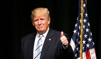 A new poll gives Donald Trump better marks than Hillary Clinton on ability to handle the economy, jobs, terrorism and national security, taxes, the federal government, gun policy and Wall Street. (Associated Press) ** FILE **