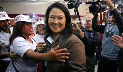 Keiko Fujimori comes with a load of political baggage to go with her 5-point lead in the most recent Ipsos poll. Her father, former President Alberto Fujimori, is serving a 25-year prison term for crimes against humanity and corruption. (Associated Press)
