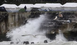 Migrant and refugee tents are set up in a new makeshift camp along the cliffs at the port of Dieppe, northern France, Thursday, June 2, 2016. A group of around 150 Albanian's have set up camp near the English channel hoping to cross to the UK. (AP Photo/Michel Spingler)