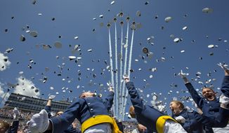 """The Air Force Thunderbirds fly overhead as graduating cadets celebrate with the """"hat toss"""" after graduation ceremonies at the 2016 class of the U.S. Air Force Academy, Thursday, June 2, 2016, in Colorado Springs, Colo. (AP Photo/Pablo Martinez Monsivais)"""