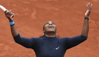 Serena Williams of the U.S. celebrates scoring a point in the quarterfinal match of the French Open tennis tournament against Kazakhstan's Yulia Putintseva at the Roland Garros stadium in Paris, France, Thursday, June 2, 2016. (AP Photo/David Vincent)
