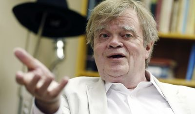 """In this July 20, 2015 file photo, Garrison Keillor, creator and host of """"A Prairie Home Companion,"""" appears during an interview in St. Paul, Minn. (AP Photo/Jim Mone, File)"""
