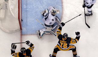 The overtime goal by Pittsburgh Penguins' Conor Sheary, not seen, bounces out of the net behind San Jose Sharks goalie Martin Jones (31) with Marc-Edouard Vlasic (44) defending as Penguins' Sidney Crosby (87) and Patric Hornqvist (72) begin to celebrate in Game 2 of the NHL hockey Stanley Cup Final series Wednesday, June 1, 2016 in Pittsburgh. The Penguins won 2-1. (AP Photo/Gene J. Puskar)
