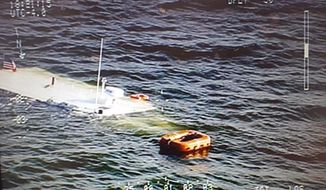 In this June 1, 2016 aerial photo released by the Maryland State Police, a charter boat belonging to the Chesapeake Bay Foundation lies in the Chesapeake Bay after sinking near Wingate, Md. A good Samaritan rescued more than 20 people, including schoolchildren, after the vessel sank Wednesday evening, authorities said. (Maryland State Police via AP)