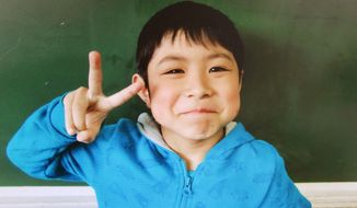 This undated photo released Friday, June 3, 2016, by Hamawake Elementary School shows 7-year-old Yamato Tanooka, who was found safe nearly a week after he was abandoned in the forest by his parents in Nanae, Hokkaido, northern Japan. (Hamawake Elementary School/Kyodo News via AP)