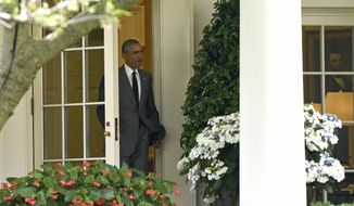 President Barack Obama walks out of the Oval Office of the White House in Washington, Friday, June 3, 2016, to head to Marine One on the South Lawn for a short trip to Andrews Air Force base, Md. Obama is heading to South Florida where he will attend Democratic fundraisers. (AP Photo/Susan Walsh)