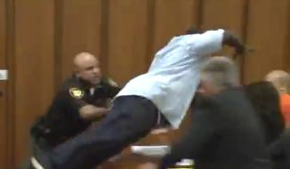 Van Terry lunges for serial killer Michael Madison in a Cleveland, Ohio, courtroom on June 2, 2016. (Fox-8 Cleveland screenshot)