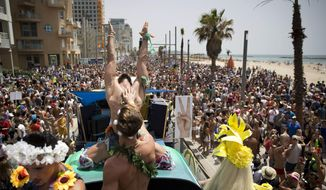 Israeli dancers perform during the annual Gay Pride Parade in Tel Aviv, Israel, Friday, June 3, 2016. About 200,000 people from the LGBT community in Israel and abroad attended in Tel Aviv's annual gay pride parade Friday, the largest event of its kind in the Middle East. (AP Photo/Oded Balilty)