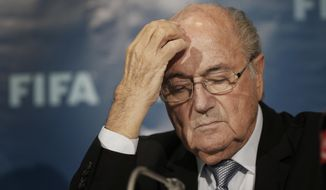 In this Dec. 19, 2014, file photo FIFA President Sepp Blatter attends a news conference in Marrakech, Morocco. Swiss attorney general's office confirms new raid Friday June 3, 21016, on FIFA, in ongoing investigations of Blatter and former FIFA secretary general Valcke. Both Blatter and Valcke deny wrongdoing. (AP Photo/Christophe Ena, FILE)