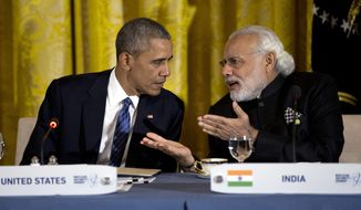 FILE - In this March 31, 2016, file photo, President Barack Obama talks with India's Prime Minister Narendra Modi during a working dinner with heads of delegations of the Nuclear Security Summit in the East Room of the White House, in Washington. After years of being denied entry to the U.S., Modi has become a welcome guest in Washington, forging a surprising bond with President Barack Obama and deepening ties with America. (AP Photo/Carolyn Kaster, File)