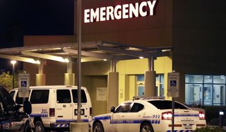 Law enforcement officers park outside the Scottsdale Osborn Medical Center, Friday, June 3, 2016, in Scottsdale, Ariz., where former heavyweight boxing champion Muhammad Ali was suspected to have been admitted. Ali passed away earlier in the evening according to a statement released by his family. He was 74. (AP Photo/Matt York)