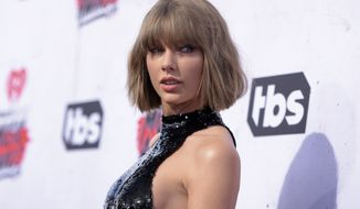 "FILE - In this April 3, 2016, file photo, Taylor Swift arrives at the iHeartRadio Music Awards at The Forum in Inglewood, Calif. The superstar played a stripped down version of her song ""Blank Space"" at Max Singer and Kenya Smith's wedding reception in Long Beach Township, N.J., on Saturday, June 4, as amazed guests looked on and sang along. (Photo by Richard Shotwell/Invision/AP, File)"