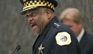 FILE - In this April 13, 2016, file photo, Eddie Johnson, left, speaks after being sworn in as the new Chicago police superintendent in Chicago. Violent crimes ranging from homicides to rapes to robberies have been on the rise in many major U.S. cities so far this year. But experts can't point to a single reason why and the jump isn't enough to suggest there's a trend. Law enforcement officials are seeking a way to combat the problem. (AP Photo/M. Spencer Green, File)