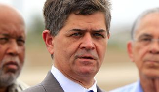 In this June 27, 2014, file photo, Rep. Filemon Vela, D-Texas talks to the media after touring the McAllen Border Patrol station, in McAllen, Texas. (Gabe Hernandez/The Monitor via AP, File)