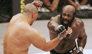 Kimbo Slice throws a punch at James Thompson of Manchester, England, during the second round of their EliteXC heavyweight mixed-martial arts bout at the Prudential Center in Newark, N.J, on March 31, 2008. (Associated Press)