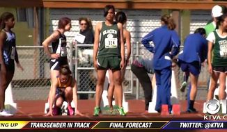 Haines High school runner Nattaphon Wangyot, center, won Alaska's all-state honors for girls track and field. Parents and some student's said the transgender student's victories are unfair. (KTVA-11 CBS Alaska screenshot)