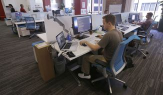 Employees work at their stations at the Target Technology Innovation Center office in San Francisco. At a 21 percent turnover rate last year, millennials were three times more likely than nonmillennials to report changing jobs, and 60 percent said they were currently open to a change in employment, more than 15 points higher than nonmillennials. (Associated Press)
