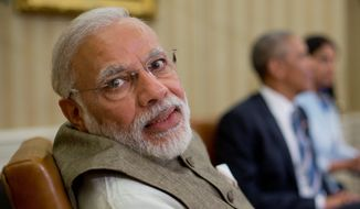Indian Prime Minister India Narendra Modi said India, whose participation was considered critical to a successful climate accord, would ratify the Paris climate agreement this year, helping to push the pact over the threshold for implementation. (Associated Press)