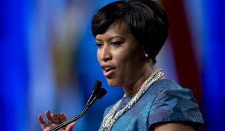 """""""I see how much it costs to live in Washington, D.C., and that cost is only going up,"""" D.C. Mayor Muriel Bowser said Tuesday, promising to sign the legislation when it reaches her desk. """"Even at $15, it's tough to be able to afford to live in Washington, D.C."""" (Associated Press)"""