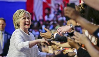 Democratic presidential candidate Hillary Clinton greets supporters as she arrives to speak during a presidential primary election night rally, Tuesday, June 7, 2016, in New York. (AP Photo/Julie Jacobson)