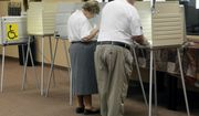 A couple fills out primary election ballots, Tuesday, June 7, 2016, at the Church at the Gate polling place in Sioux Falls, S.D. Poll workers say turnout was light Tuesday morning. (AP Photo/Dirk Lammers)