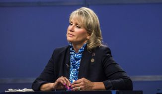 FILE- In this Thursday, May 19, 2016, file photo, Rep. Renee Ellmers listens while facing off with Dr. Greg Brannon and Rep. George Holding during the 2nd Congressional District Republican primary debate at WRAL studio in Raleigh, N.C. The most watched race in the congressional primaries on Tuesday, June 7, is the 2nd District GOP, where two sitting members of Congress are running against each other for the first time since 2012: George Holding of Raleigh and Ellmers of Dunn. Cary obstetrician Greg Brannon is also in the race. (Travis Long/The News & Observer via AP, Pool, File)