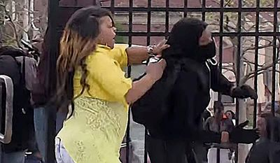 Toya Graham disciplining her son on the street in Baltimore last year