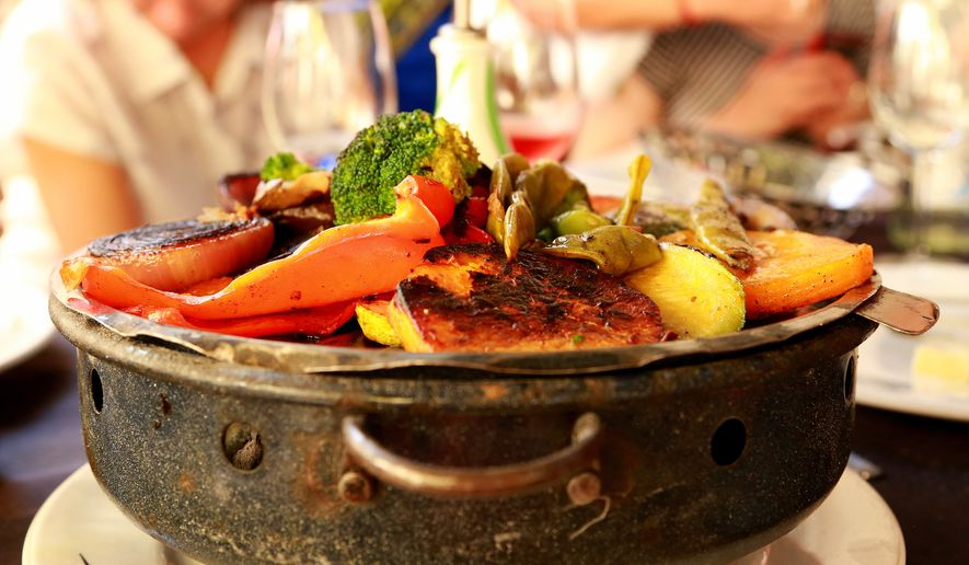 This picture taken March 13, 2016, shows grilled vegetables as served at El Palenque, one of the parillas, or grill restaurants, in Montevideo's Mercardo del Puerto, a popular place for lunch. Montevideo may not be as well known to travelers as some other Latin American destinations but there is plenty to see and do in this friendly, laid-back city, from beach strolls to late-night dinners.  (Michelle Locke via AP)