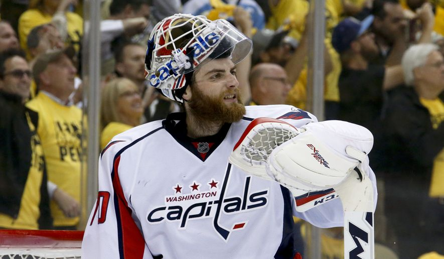 Washington Capitals goalie Braden Holtby adjusts his mask after Pittsburgh Penguins' Phil Kessel scored during the second period of Game 6 of the NHL hockey Stanley Cup Eastern Conference semifinals, Tuesday, May 10, 2016 in Pittsburgh. (AP Photo/Gene J. Puskar)