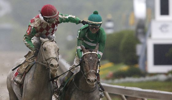 Kent Desormeaux riding Exaggerator is congratulated by Corey Lanerie atop Cherry Wine after the 141st Preakness Stakes horse race at Pimlico Race Course, Saturday, May 21, 2016, in Baltimore. Exaggerator won the race. (AP Photo/Patrick Semansky)