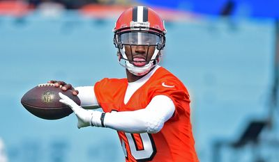 FILE - In this April 19, 2016, file photo, Cleveland Browns' Robert Griffin III throws a pass during practice at the NFL football team's veteran minicamp in Berea, Ohio. The Browns quarterback posed as a mannequin on Tuesday, May 3, 2016, before surprising a high school team during a presentation by the NFL team. Griffin stood silently on stage in a helmet and full uniform before No. 10 lunged at two unsuspecting players from North Ridgeville High School. RG3 then pulled off his helmet to reveal his identity as the group roared. (AP Photo/David Dermer, File)