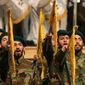 Hezbollah fighters swear the oath of allegiance to their group during a ceremony marking the death of Hezbollah commander Mustafa Badreddine, who was killed in an explosion, in a southern suburb of Beirut, Lebanon. (Associated Press)