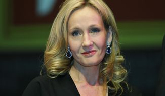 In this Thursday, Sept. 27, 2012 file photo, British author J.K. Rowling poses for photographers at the Southbank Centre in London. (AP Photo/Lefteris Pitarakis, File)