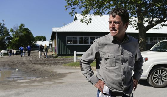 Keith Desormeaux, trainer for Belmont Stakes hopeful and Preakness Stakes winner Exaggerator, pauses while answering questions for the media at Belmont Park, Thursday, June 9, 2016, in Elmont, N.Y. Exaggerator will compete in the 148th running of the Belmont Stakes horse race on Saturday. (AP Photo/Julie Jacobson)