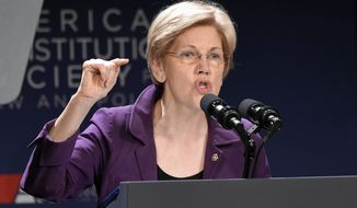 Sen. Elizabeth Warren, D-Mass., speaks at the American Constitution Society for Law and Policy 2016 National Convention, Thursday, June 9, 2016, in Washington. (AP Photo/Nick Wass)