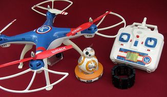 Swann's Gravity Pursuit Quadcopter, Sphero's BB-8 and Thalmic Labs' Myo Armband are some last-minute Father's Day gift ideas. (Photograph by Joseph Szadkowski/The Washington Times)