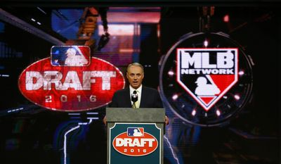 Commissioner Rob Manfred speaks during the Major League Baseball draft, Thursday, June 9, 2016, in Secaucus, N.J. (AP Photo/Julio Cortez)