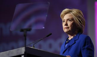 Democratic presidential candidate Hillary Clinton pauses while speaking during a Planned Parenthood Action Fund membership event, Friday, June 10, 2016 in Washington. (AP Photo/Alex Brandon)