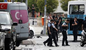 FILE - In this Tuesday, June 7, 2016 file photo, Turkish police work at the scene of an explosion in Istanbul. Well before police could establish who was responsible for the car bombing, the government had banned the media from reporting anything about the investigation. Bans have been implemented after such incidents since 2013 and have become so routine that some joke on Twitter that the ban arrives before the ambulance _ but they're part of what free-speech advocates say is an increasingly concerning pattern of restricting news coverage in Turkey. (Associated Press)