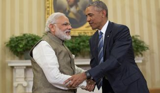 FILE -  In this June 7, 2016, file photo, U.S. President Barack Obama and Indian Prime Minister India Narendra Modi shake hands before their meeting in the Oval Office of the White House in Washington. India is rejoicing over news on Saturday, June 11, 2016, that Modi brokered deals with U.S. officials to bring New Delhi closer to its long-held dream of joining an elite group of nations allowed to control the global trade in nuclear materials, equipment and technology. Newspapers have run daily front-page stories heralding progress on the nuclear front after Obama came out in support of Indian membership in the Nuclear Suppliers Group, which led other nations including Mexico and Switzerland to suggest they, too, were on board. (AP Photo/Pablo Martinez Monsivais, File)