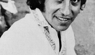 FILE - In this undated file photo, singer and songwriter Victor Jara poses in Chile. The ghosts of Chile's four-decade-old, bloody coup d'etat, which led to the torture and disappearance of thousands of political opponents, are coming to an Orlando, Florida courtroom with the start of a civil trial involving a military commander and the family of Victor Jara. The family of Jara is suing Lt. Pedro Pablo Barrientos Nunez, a former military officer in the regime of Gen. Augusto Pinochet for damages, claiming that Barrientos Nunez was in charge of the stadium where Jara was tortured and killed in 1973. The trial starts in Orlando, Fla., Monday, June 13. 2016. (AP Photo, File)