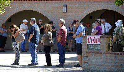 Voters wait in line to cast their ballot in Arizona's presidential primary election on March 22 in Gilbert, Ariz. (Associated Press)